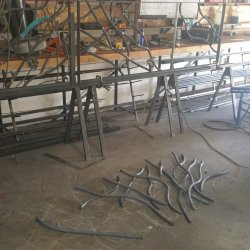 fitting and welding the branches into the actual railing frame