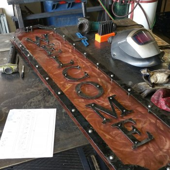Copper and Hammered Iron Welcome sign